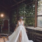 Simple wedding gown with a split on the skirt